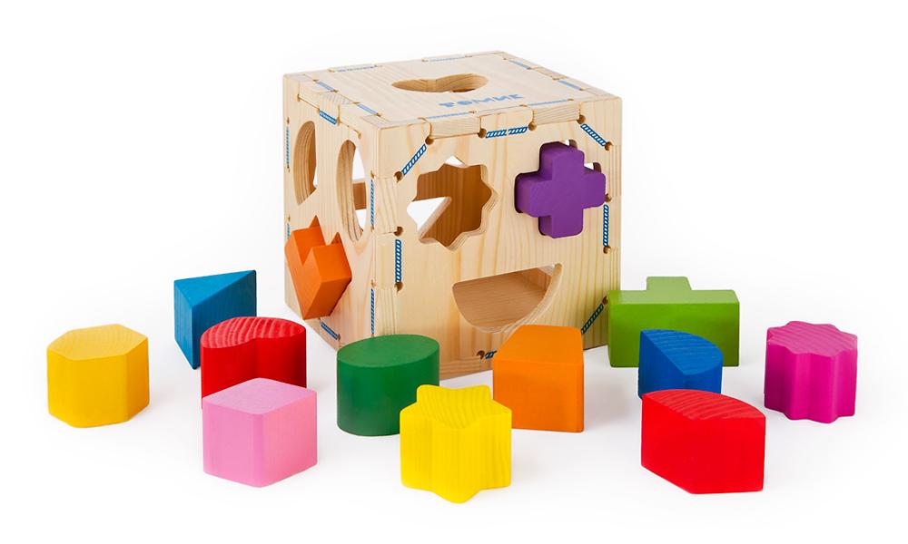 Сортер «Геометрические фигуры» 14 дет. (Томик) - Множество разных по форме фигурок должны попасть внутрь кубика через отверстия в его гранях.