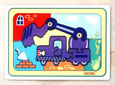 Развивающая головоломка Экскаватор - Игра представляет собой мозаику, которую требуется составить из множества фрагментов рисунка различной формы.