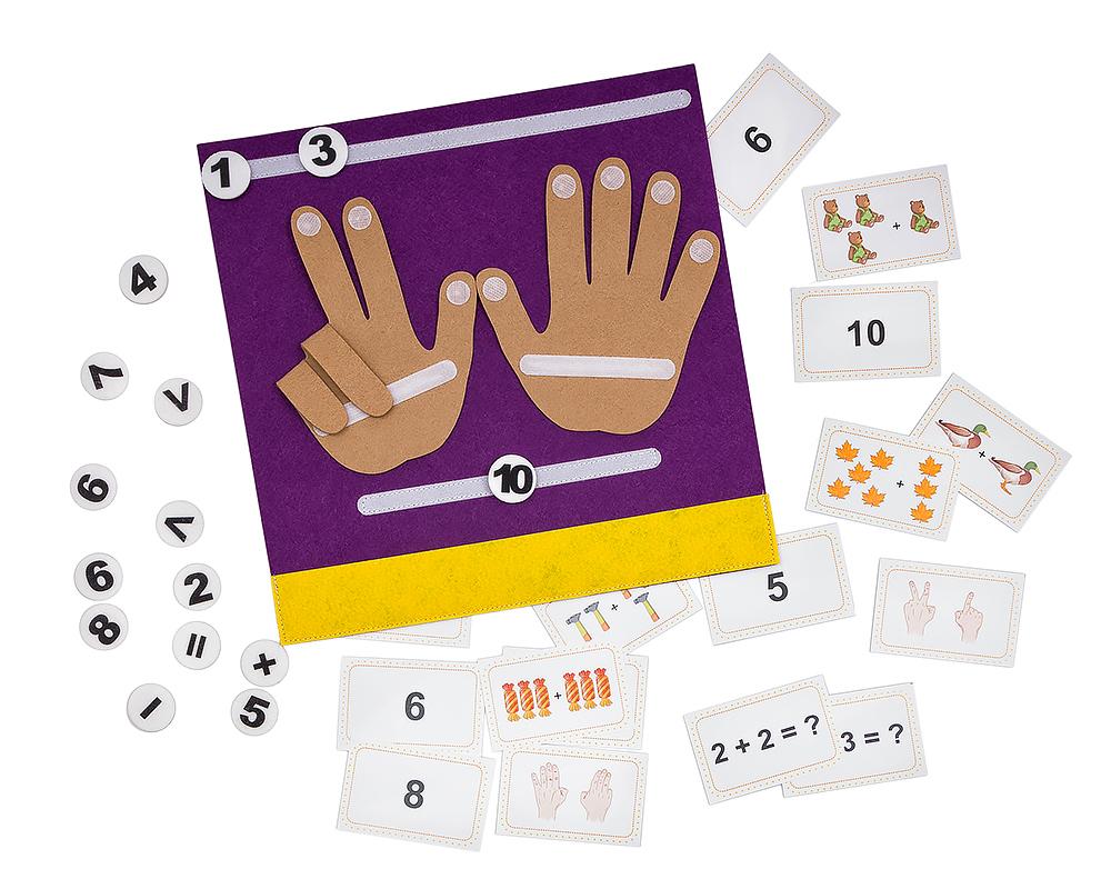 Коврик-считалка Пальчики - Материал: фетр, бумага Размер коврика: 31см*31 см Размер карточек: 9 см*5,8 см В наборе: 20 карточек